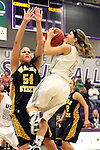 SIOUX FALLS, SD - DECEMBER 6:  Marie Malloy #4 from the University of Sioux Falls shoots over Shantel Lehmann #54 from Wayne State in the first half of their game Friday night at the Stewart Center. (Photo by Dave Eggen/Inertia)