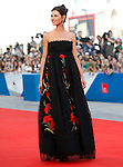 Bianca Balti poses on the red carpet at the opening of the 71st Venice Film Festival in Venice, on August 27, 2014.