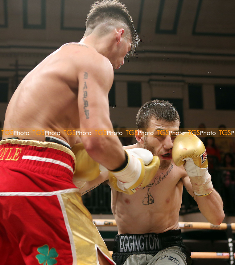 Johnny Coyle (red shorts) defeats Sam Eggington (black & grey shorts) - Welterweights IV Prize Fighter Semi-Final - Boxing at York Hall, Bethnal Green, London - 05/04/14 - MANDATORY CREDIT: Rob Newell/TGSPHOTO - Self billing applies where appropriate - 0845 094 6026 - contact@tgsphoto.co.uk - NO UNPAID USE