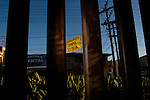 Fingerprints from illegal aliens smudge the border fence seperating the U.S. from Mexico as a sign in Mexicali, Mexico reads &quot;Insurance for U.S.A.&quot; on Monday, March 28, 2005.<br />