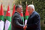 Palestinian President Mahmoud Abbas is greeted by Jordanian King Abdullah II, during his visiting, in Amman, Jordan on Aug. 08, 2018. Photo by Thaer Ganaim