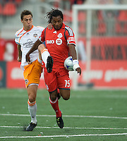 18 July 2009: Toronto FC defender Adrian Serioux #15 battles for a ball with Houston Dynamo defender Geoff Cameron #20 during a game between the Toronto FC and Houston Dynamo..The game ended in a 1-1 draw..