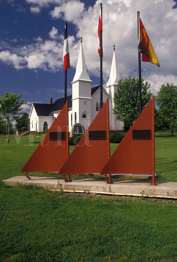 church, Shemogue, New Brunswick, NB, Canada, Boat sculpture with flags outside the church in the town of Shemogue in New Brunswick.