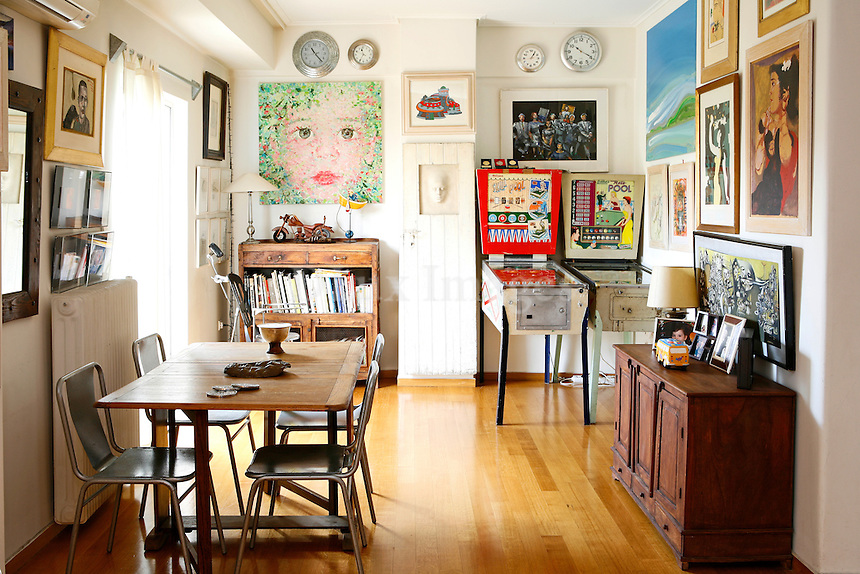 contemporary dining room with artworks...Giorgos Kartalos lives with his wife Christina Papamihou in a 130 square feet contemporary house located in Athens, Greece which is decorated with 185 famous artworks.