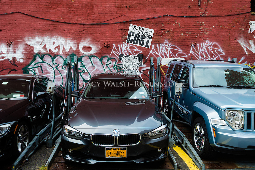 New York, NY - 8 August 2015 - TriBeCa parking lot with upscale cars and graffiti