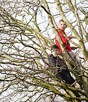 Two young Fleetwood fans watch the match from a tree overlooking Highbury Stadium, home of Fleetwood Town <br /> <br /> Photographer Lee Parker/CameraSport<br /> <br /> The EFL Sky Bet League One - Fleetwood Town v Blackpool - Saturday 7th March 2020 - Highbury Stadium - Fleetwood<br /> <br /> World Copyright © 2020 CameraSport. All rights reserved. 43 Linden Ave. Countesthorpe. Leicester. England. LE8 5PG - Tel: +44 (0) 116 277 4147 - admin@camerasport.com - www.camerasport.com