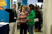 Current student giving directions, Open Day at Kingston College when prospective students and their parents look around.