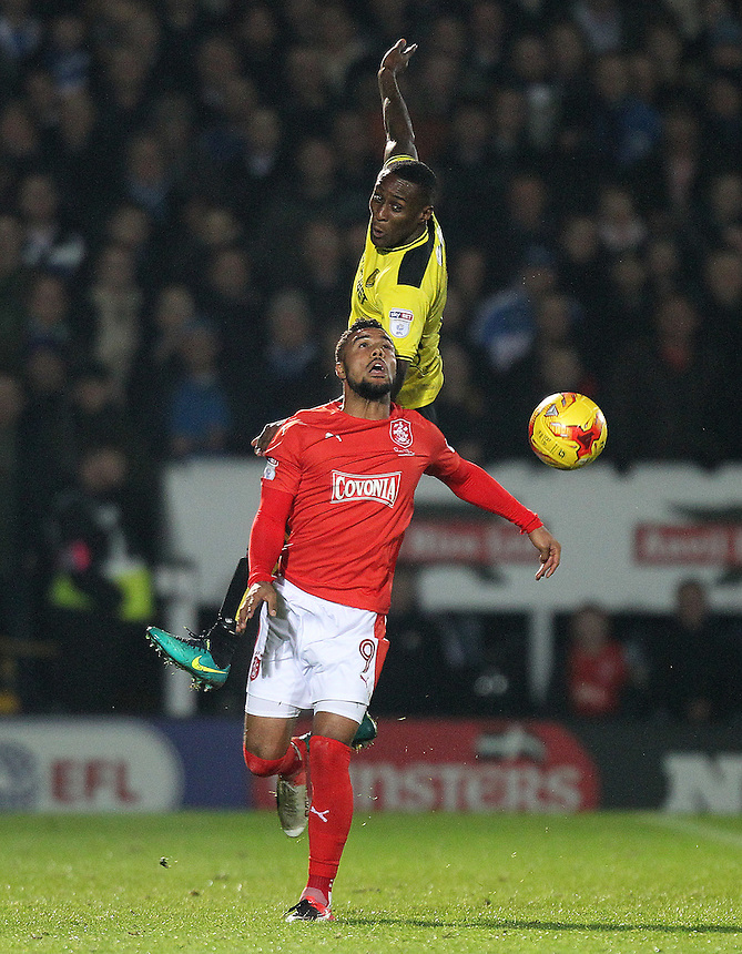 \Huddersfield Town's Elias Kachunga battles with  Burton Albion's Lloyd Dyer<br /> <br /> Photographer Mick Walker/CameraSport<br /> <br /> The EFL Sky Bet Championship - Burton Albion v Huddersfield Town - Tuesday 13th December 2016 - Pirelli Stadium - Burton upon Trent<br /> <br /> World Copyright &copy; 2016 CameraSport. All rights reserved. 43 Linden Ave. Countesthorpe. Leicester. England. LE8 5PG - Tel: +44 (0) 116 277 4147 - admin@camerasport.com - www.camerasport.com