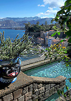 View of the small fishing port and the bay of Naples from the swimming pool