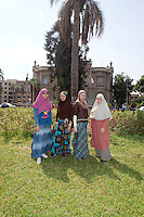 Menna, Heba Tallah, Asmaa and Heba Ahmed of the Noor Family, sit in the campus of Ain Shams University in Cairo, where they study law. Cairo, Egypt. October 9th, 2012.