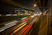 Cinematic night view of Austin's transportation corridor, speeding car traffic on the upper and lower deck on I-35 in downtown Austin, Texas.