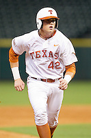 Kacy Clemens #42 of the Texas Longhorns hustles towards third base against the Rice Owls at Minute Maid Park on February 28, 2014 in Houston, Texas.  The Longhorns defeated the Owls 2-0.  (Brian Westerholt/Four Seam Images)