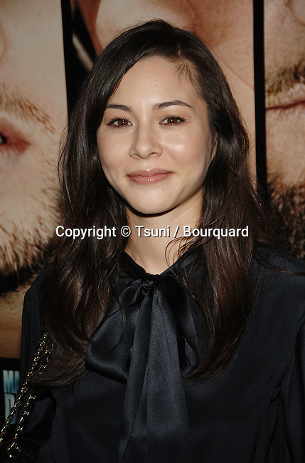China Chow arriving at the Departed LA Screening  at The DGA  In Los Angeles.<br /> <br /> headshot<br /> smile<br /> eye contact<br /> black dress