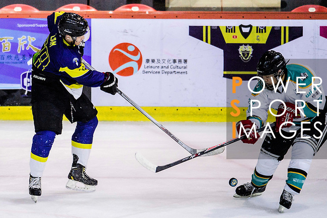 Verity Skater #58 Mike Lam (l) battle for the puck with Medical Kings Forward #11 Danny Chiu (r) during the Principal Standard League match between Medical Winner Kings vs Verity at the Mega Ice on 17 January 2017 in Hong Kong, China. Photo by Marcio Rodrigo Machado / Power Sport Images