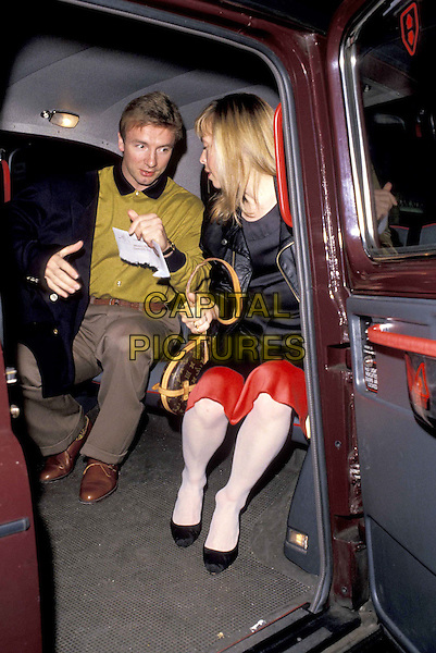 TORVILL & DEAN.ref:1203.cab, taxi, car, sitting.www.capitalpictures.com.sales@capitalpictures.com.©Capital Pictures