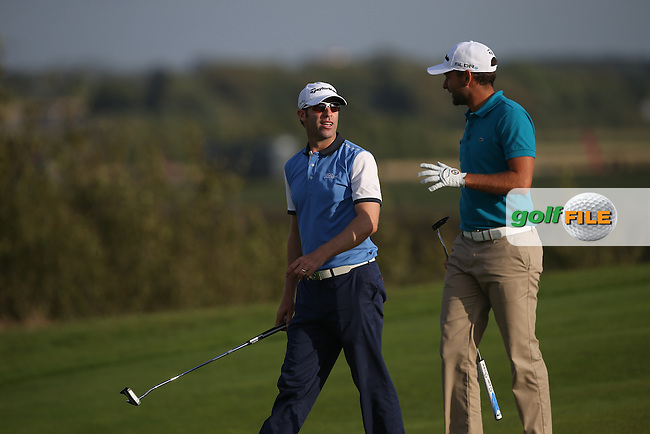 Bradley Dredge (WAL) chats with Carlos Del Moral (ESP) down the 15th during Round Two of the Made in Denmark 2014 Pro-Am from the Himmerland Golf & Spa Resort, Aalborg, Denmark. Picture:  David Lloyd / www.golffile.ie