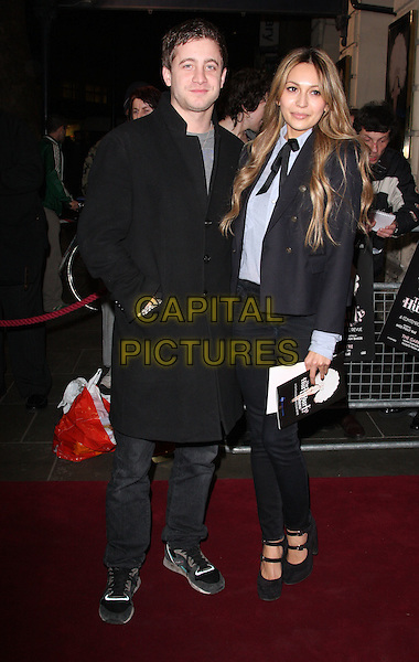 TYRONE WOOD & ZARA MARTIN .Press night for 'The Hurly Burly Show' at the Garrick Theatre, London, England, March 11th 2011..full length black coat jeans jacket blazer tie bow shirt ty mary janes shoes navy blue .CAP/ROS.©Steve Ross/Capital Pictures