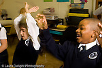 Special education classroom mixed ages elemetary school children doing physical activity in class horizontal