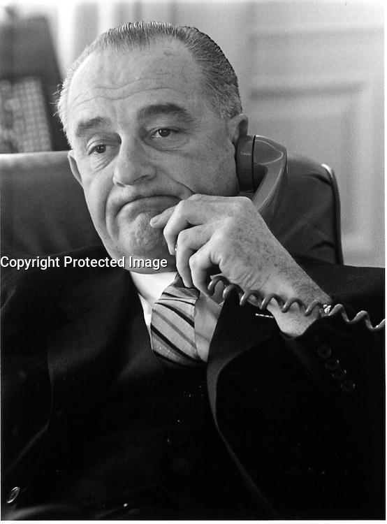 LBJ on the telephone. Jan. 10, 1964.<br /> <br /> Credit: LBJ Library Photo by Yoichi R. Okamoto