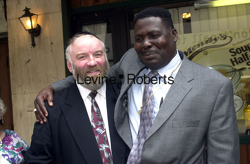 IN ADVANCE FOR 20TH ANNIVERSARY OF CROWN HEIGHTS RIOTS IN BROOKLYN, NY ON AUGUST 19, 1991. Norman Rosenbaum and Carmel Cato meet for lunch with NYS Gov. George Pataki on August 19, 2002,  the anniversary of the Crown Heights riots in 1991. Cato' s son Gavin was killed in an automobile accident by a driver driving the late Grand Rebbe Menachen Schneerson sparking four days of rioting in Crown Heights, Brooklyn. Rosenbaum's brother, a Rabbinical student, was stabbed and killed by a rioting mob.  The two met for the first time last year and hope that their friendship will serve as an example against racism and anti-semitism. (© Richard B. Levine)