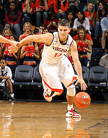 Nov 6, 2010; Charlottesville, VA, USA; Virginia Cavaliers g Joe Harris (12) drives the ball down court Saturday afternoon in exhibition action at John Paul Jones Arena. The Virginia men's basketball team recorded an 82-50 victory over Roanoke College.