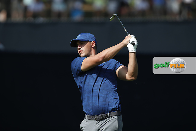Brooks Koepka (USA) hits his second shot on the 9th hole during the first round of the 100th PGA Championship at Bellerive Country Club, St. Louis, Missouri, USA. 8/9/2018.<br /> Picture: Golffile.ie | Brian Spurlock<br /> <br /> All photo usage must carry mandatory copyright credit (© Golffile | Brian Spurlock)