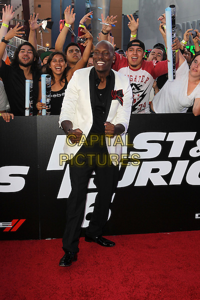 "Tyrese Gibson.""Fast & Furious 6"" Los Angeles Premiere held at the Universal Gibson Amphitheatre, Universal City, California, USA..May 21st, 2013.full length shirt suit jacket trousers black white shirt smiling fists fans crowd .CAP/ADM/KB.©Kevan Brooks/AdMedia/Capital Pictures"