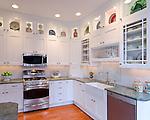 White cabinets, black granite countertops