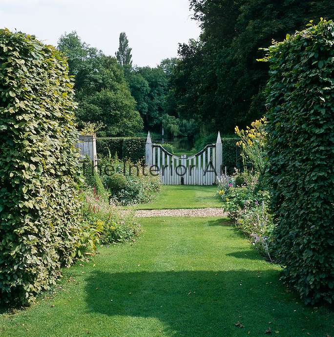 View from the folly to the white-painted gate at the bottom of the garden