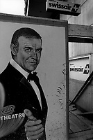 Switzerland. Canton Zürich. Avertisements billboards for Swissair and a movie theater with Sean Connery's drawing as James Bond. For most of its 71 years, Swissair was one of the major international airlines and was regarded as a Swiss national symbol and icon. The airline was declared bankrupt on March 31 2002. Sir Thomas Sean Connery was the first actor to portray the character James Bond in film, starring in seven Bond films between 1962 and 1983. The James Bond series focuses on a fictional British Secret Service agent created in 1953 by writer Ian Fleming, who featured him in twelve novels and two short-story collections. © 1988 Didier Ruef