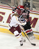 Emily Field (BC - 15), Sonia St. Martin (NU - 12) - The Boston College Eagles defeated the Northeastern University Huskies 3-0 on Tuesday, February 11, 2014, to win the 2014 Beanpot championship at Kelley Rink in Conte Forum in Chestnut Hill, Massachusetts.