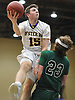 Anthony Reilly #15 of Oyster Bay tries to drive to the hoop but gets whistled for a charge on Matthew Morrison #23 of Carle Place during the Nassau County varsity boys basketball Class B semifinals at Farmingdale State College on Sunday, Feb. 18, 2018. Oyster Bay won by a score of 68-52.