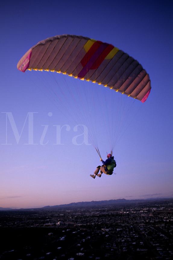 Para gliding off mountain at sunset in Tuscon Arizona USA