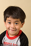closeup headshot portrait of boy age 3 vertical