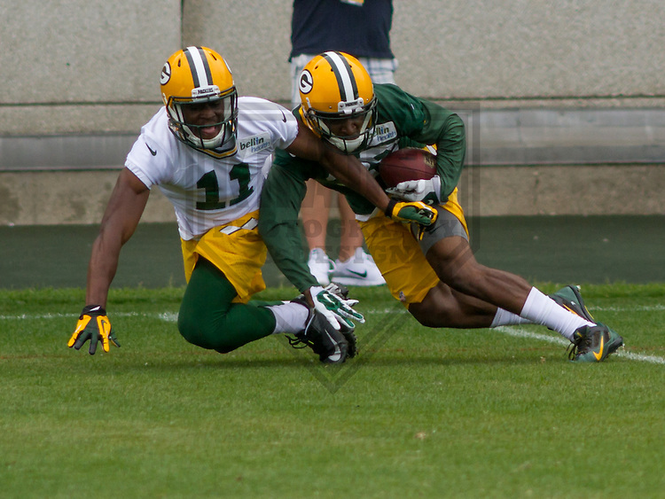GREEN BAY - June 2015: Green Bay Packers cornerback Demetri Goodson (39) intercepts a pass in front of wide receiver Larry Pinkard (11) during a minicamp practice on June 18th, 2015 at Clarke Hinkle Field in Green Bay, Wisconsin. (Brad Krause/Krause Sports Photography)