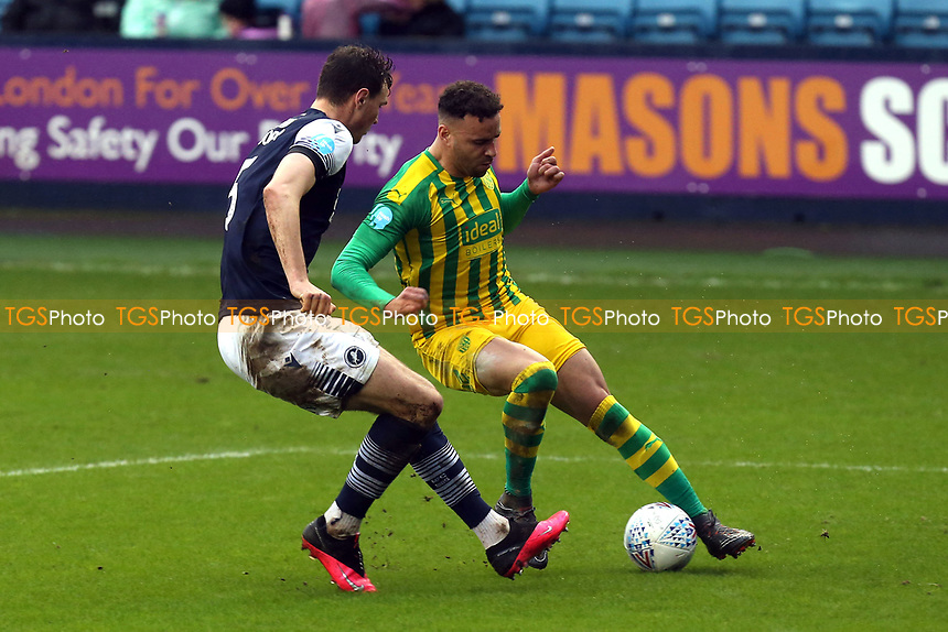 Hal Robson-Kanu of West Bromwich Albion and Jake Cooper of Millwall during Millwall vs West Bromwich Albion, Sky Bet EFL Championship Football at The Den on 9th February 2020