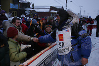 Robert Sorlie is congratulated by spectators at the finish line in Nome.  End of the  2005 Iditarod Trail Sled Dog Race.