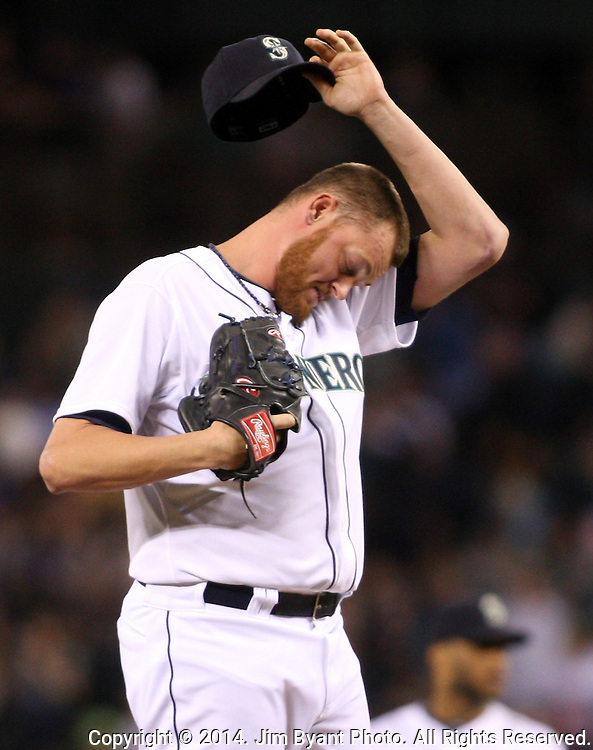 Seattle Mariners pitcher Charlie Furbush whips his brow after pitching against the Oakland Athletics  September 13, 2014 at Safeco Field in Seattle. The Athletics beat the Mariners 3-2 when Mariners pitcher Fernando Rodney  walked in Coco Crisp in the 10th inning.  ©2014. Jim Bryant Photo. All Rights Reserved.