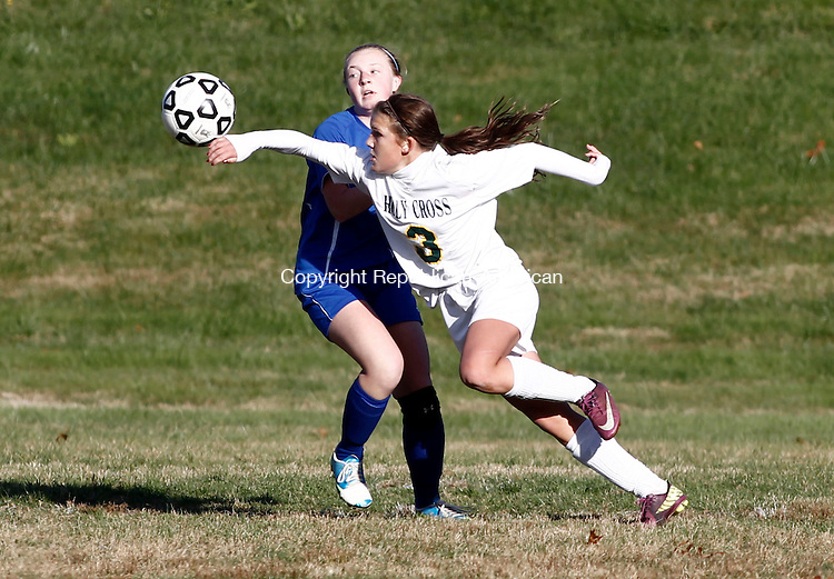Waterbury, CT- 04 November 2013-110413CM02- Holy Cross' Julia Sheetz (3) goes after the ball against Seymour's Halley Slotter during the Class M state tournament in Waterbury Monday afternoon.  Cross won, 3-0.    Christopher Massa Republican-American