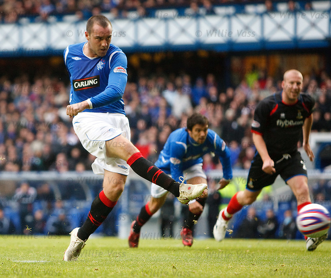 Kris Boyd scores from the penalty spot to seal his hat-trick.