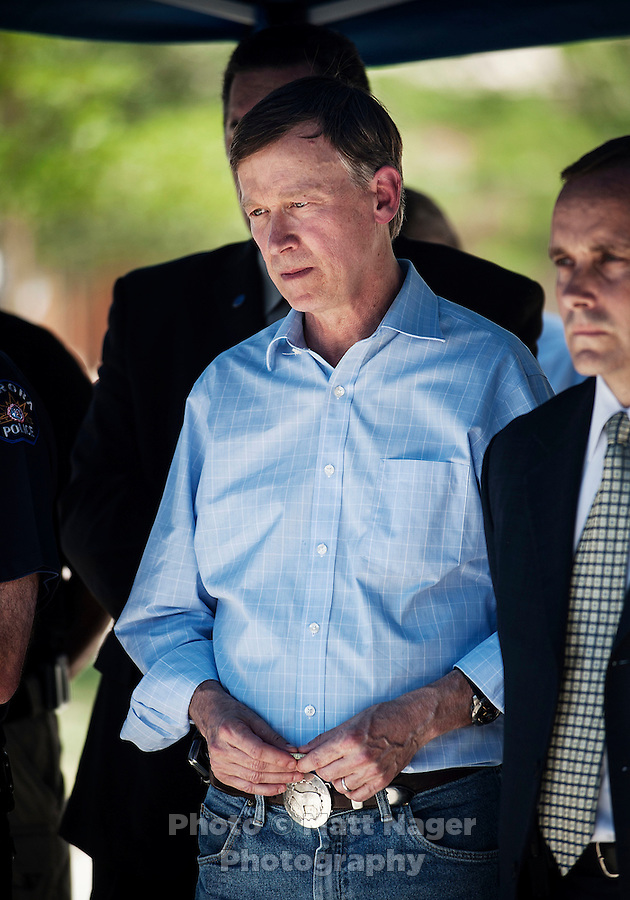 Colorado Governor John Hickenlooper (cq) stands during a press conference at the Aurora Municipal Center Saturday, July 21, 2012 regarding the mass shootings from the Aurora Century 16 movie theater in Aurora, Colorado. The shootings occurred during the midnight premiere of the new Dark Knight Batman movie...Photo by MATT NAGER