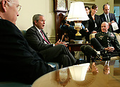 Washington, D.C. - June 14, 2007 -- United States President George W. Bush (2nd L) speaks to the media as he meets with Army Lieutenant General Martin E. Dempsey (R), former Commanding General of Multi-National Security and Transition Command Iraq, as Vice President Dick Cheney (L) looks on in the Oval Office of the White House on Thursday, June 14, 2007 in Washington, DC.  Army Lieutenant General James Dubik has succeeded Dempsey to take over the command on June 10, 2007 in Baghdad.  <br /> Credit: Alex Wong - Pool via CNP
