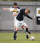 Paul McGinn clips Jim McAlister in the box for a penalty to Dundee