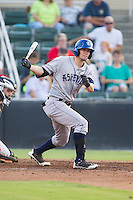 David Dahl (21) of the Asheville Tourists follows through on his swing against the Kannapolis Intimidators at CMC-NorthEast Stadium on July 12, 2014 in Kannapolis, North Carolina.  The Tourists defeated the Intimidators 7-5 in 15 innings.  (Brian Westerholt/Four Seam Images)