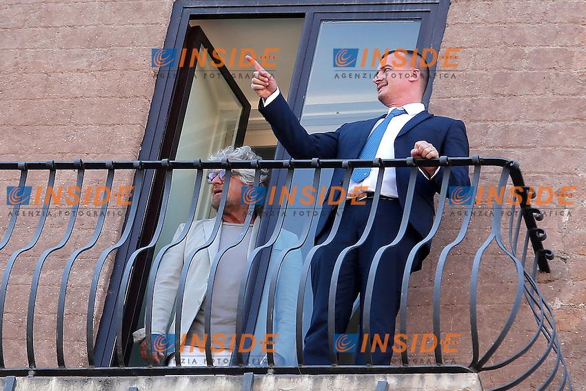 Beppe Grillo e Rocco Casalino<br /> Roma 12-07-2016 Campidoglio, Beppe Grillo si affaccia al balcone durante il suo incontro con la Sindaca di Roma.<br /> Beppe Grilo look out from the balcony of Campidoglio during the meeting with the newly elected mayor of Rome<br /> Photo Samantha Zucchi Insidefoto