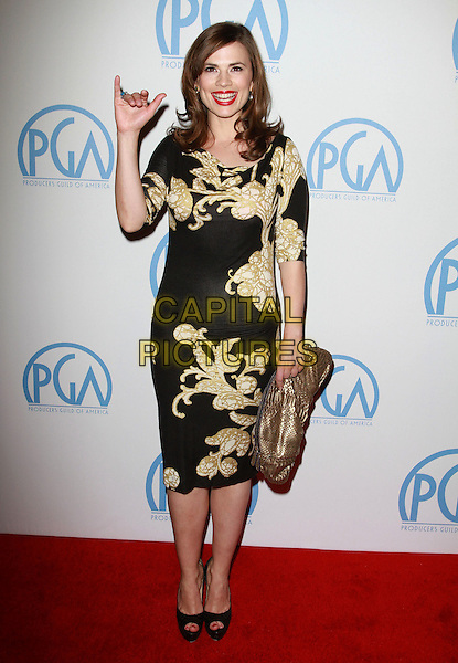 HAYLEY ATWELL .22nd Annual Producers Guild Awards held At The Beverly Hilton Hotel, Beverly Hills, CA, USA, 22nd January 2011..full length black gold print dress hand waving clutch bag jersey Vivenne Westwood  peep toe platform shoes .CAP/ADM/KB.©Kevan Brooks/AdMedia/Capital Pictures.