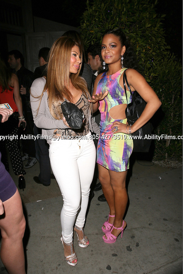.April 10th 2012   Tuesday night ..Christina Milian wearing Pink shoes tight green yellow purple blue rainbow dress short skirt showing off legs smiling at Sur Lounge in West Hollywood..AbilityFilms@yahoo.com.805-427-3519.www.AbilityFilms.com.