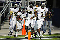 30 March 2012:  FIU's Rockey Vann (89) and Donald Senat (59) celebrate a touchdown by Shane Coleman (20) at the FIU Football Spring Game at University Park Stadium in Miami, Florida.