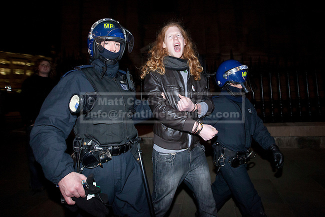 28/02/2012. LONDON, UK. Detained by police an Occupy London demonstrator shouts he is led to a waiting police van. After being camped outside St Paul's Cathedral in London for four months anti-capitalist Occupy London demonstrators were tonight evicted by police and bailiffs who moved in shortly after midnight. Photo credit: Matt Cetti-Roberts