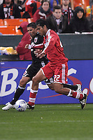 Chicago Fire defender William  Conde (22) shields the ball against DC United forward Jaime Moreno (99)  Chicago Fire tied  DC United 1-1 at  RFK Stadium, Saturday March 28, 2009.